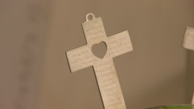 pull focus on a cross decorated with the lord's prayer. - religious illustration stock videos and b-roll footage
