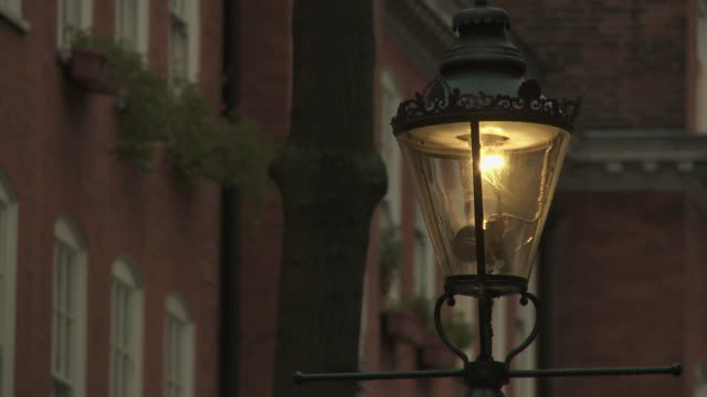 Pull focus on a gas street lamp in London.