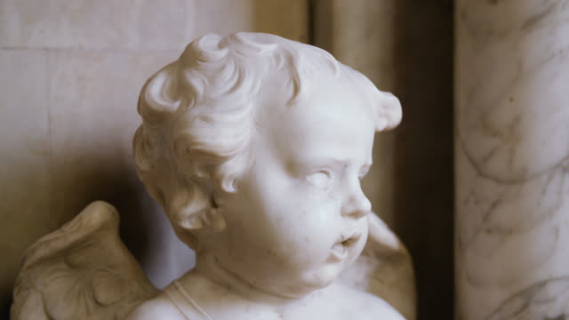 pull focus on a marble cherub - marble stock videos & royalty-free footage