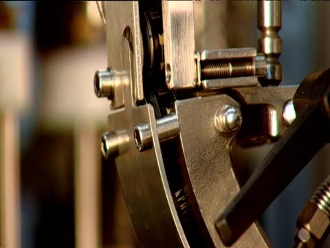 vídeos y material grabado en eventos de stock de pull focus on bottles tops moving down machine in vodka factory moscow - accesorio de cabeza
