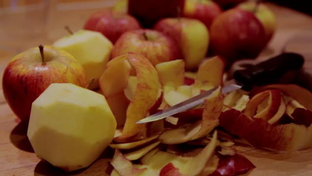 pull focus on peeled apples - home economics stock videos & royalty-free footage