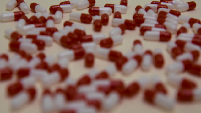Pull focus on red and white pills.