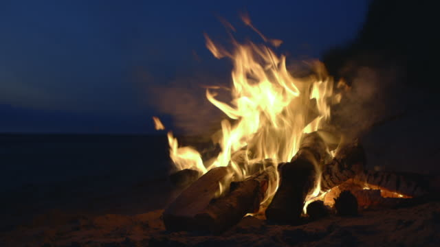 pull focus onto a beach campfire - flame stock videos & royalty-free footage