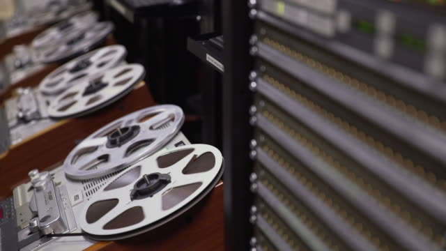 Pull focus onto a computer server from a bank of 'Struder' reel to reel film players