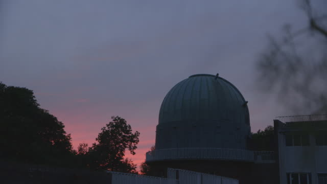 pull focus onto a dome housing a telescope at dusk - observatory stock videos & royalty-free footage