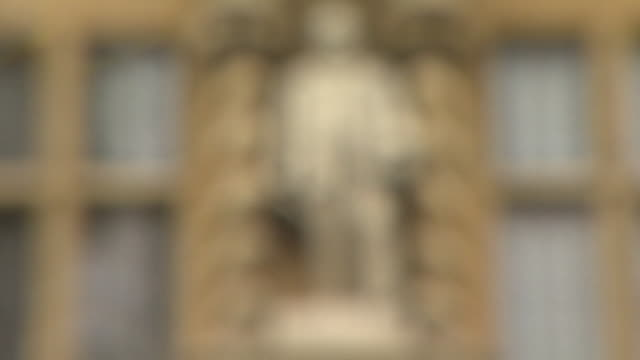 pull focus onto a statue of cecil rhodes above the main entry to oriel college, oxford - 20 24 years stock videos & royalty-free footage