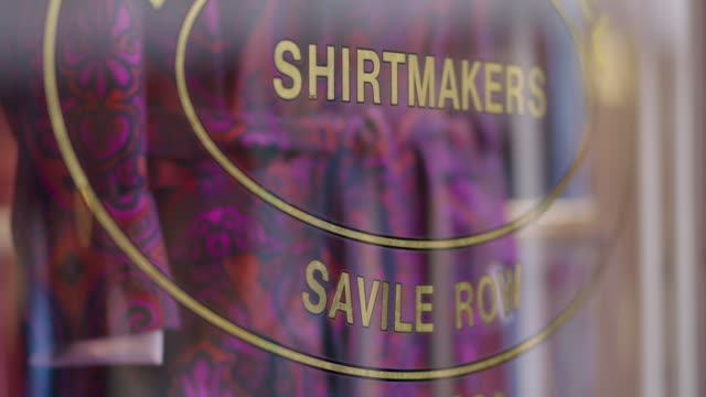 pull focus onto text on a tailors' shop window reading 'shirtmakers - savile row', london, uk. - savile row stock videos and b-roll footage