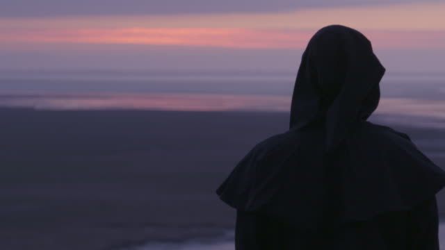 pull focus reenactment of benedictine monk looking at sunset - reenactment stock videos & royalty-free footage