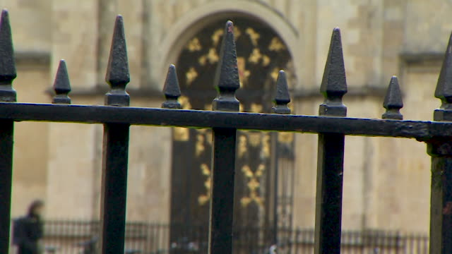 pull focus shot from railings to an ornate gold doorway at oxford university, oxford - oxford university stock videos & royalty-free footage