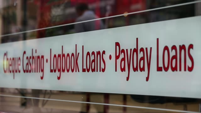 pull focus shot loan shop signage on shop front window payday loan stores are to face tougher regulations after moves proposed by the financial... - pawnbroker stock videos & royalty-free footage