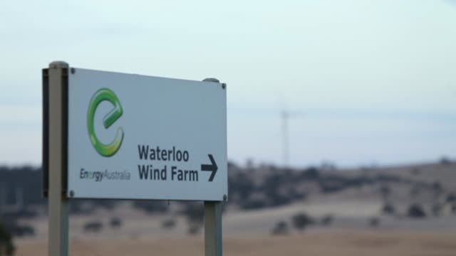 pull focus shot of waterloo wind farm signpost with windmill in background. south australian epa to investigate wind farm health implications on... - birdsong stock videos & royalty-free footage