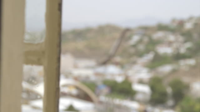 Pull focus shot on a section of the US/Mexican border in the town of Nogales.