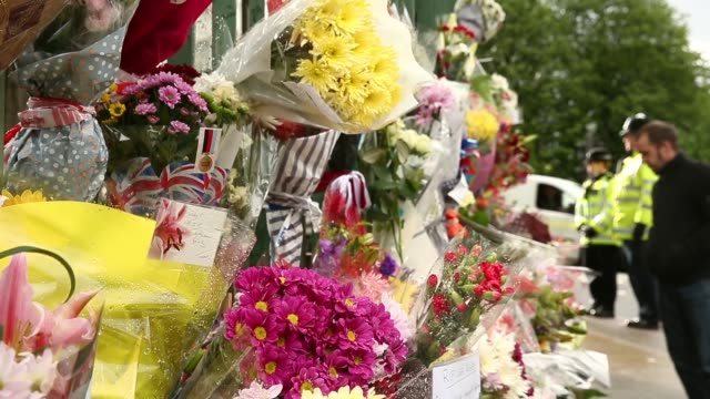 pull focus shot on flowers left at the scene where drummer lee rigby of the 2nd battalion the royal regiment of fusiliers was killed, on may 24, 2013... - fundamentalism stock videos & royalty-free footage