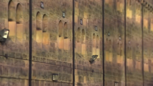 pull focus through bars showing exterior of hmp liverpool prison and the windows of the prison cells - rack focus stock videos & royalty-free footage