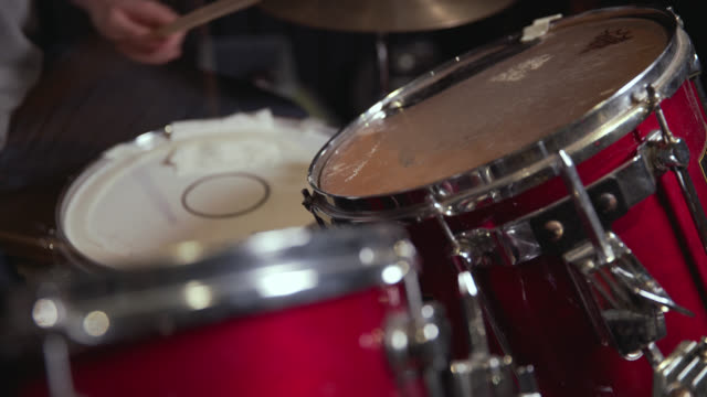 pull focus to a high tom being hit on a drum kit - repetition stock videos and b-roll footage