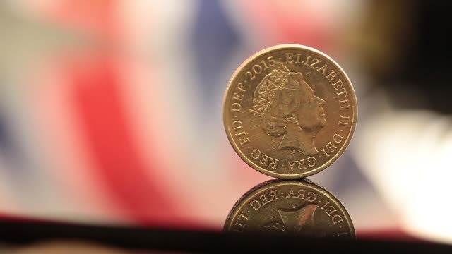 pull focuses and changing light on one pound sterling coins in london united kingdom on monday june 13 2016 - pound sterling symbol stock videos & royalty-free footage