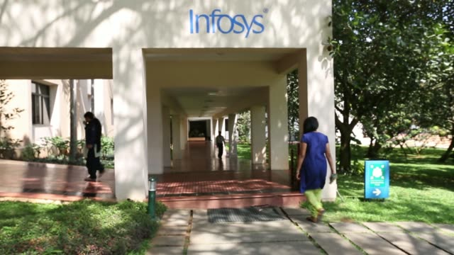 pull out the infosys ltd logo is displayed atop a building at the company's campus in electronics city in bangalore india on monday jan 27 a buggy... - push cart stock videos and b-roll footage