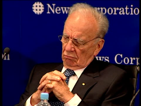 pull out to reveal wide shot lachlan, rupert and chernin.. rupert murdoch answers questions about results in adelaide, australia - law stock videos & royalty-free footage