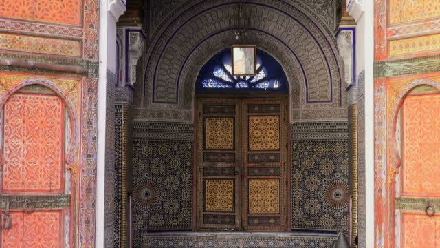 Pullback shot of the entrance to a palace in Fes, Morocco