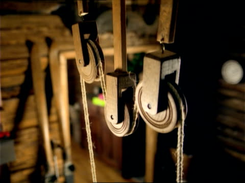 cu, pan, pulley in wooden cabin, slovenia - pulley stock videos & royalty-free footage
