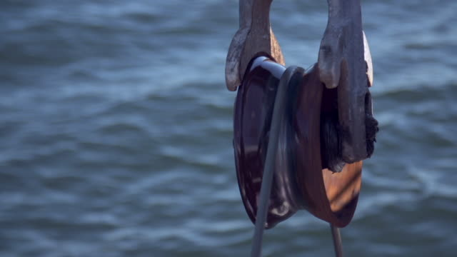 pulley rotating as it pulls a fishing net on a shrimp boat - pulley stock videos & royalty-free footage