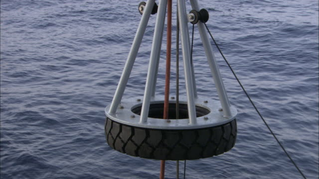 pulleys hoist up a small submarine. - pulley stock videos & royalty-free footage