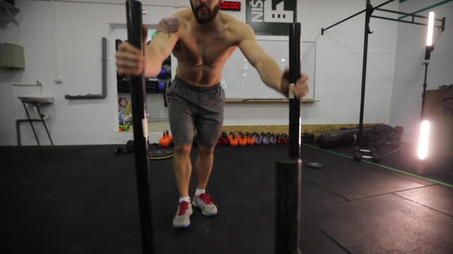 pulling and pushing sled at gym - pushing stock videos & royalty-free footage