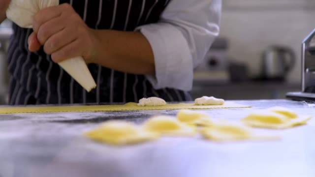 pulling focus from ravioli pasta to piping bag - stuffed stock videos & royalty-free footage