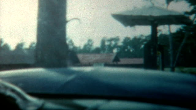 pulling into gas station 1940's - collector's car stock videos and b-roll footage