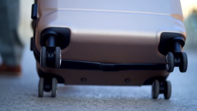 pulling luggage - bagaglio video stock e b–roll