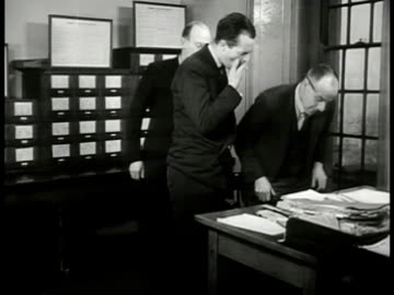 pulling out file from cabinet. inspector finch' at desk w/ men looking at file. opening file mug shots 'criminal record william mead.' finch' at desk... - 1949 stock videos & royalty-free footage