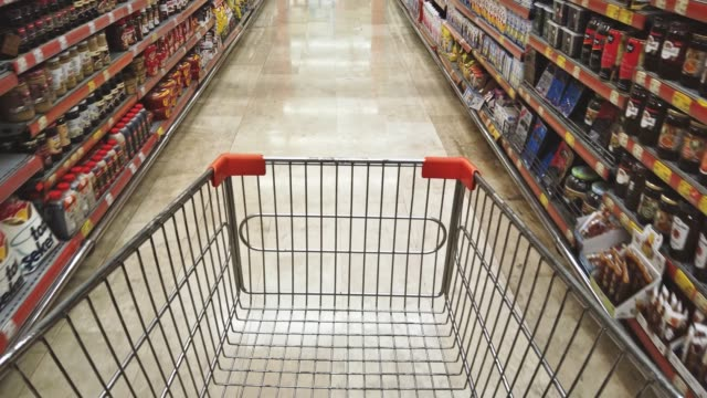 pulling shopping trolley at a supermarket - pov - shelf stock videos & royalty-free footage