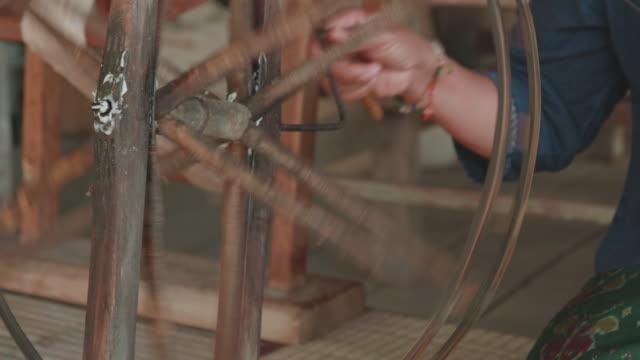 cu : pulling silk from cocoons silkworm - filo articolo di merceria video stock e b–roll