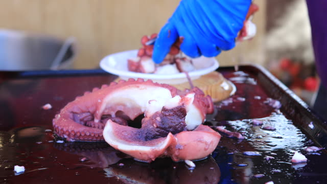 pulpo a feira - boiled octopus in fair - pulpo stock videos & royalty-free footage
