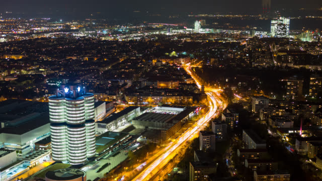 pulsating munich seen from above during night and rush hour - time lapse - shot-2 - bmw stock videos & royalty-free footage