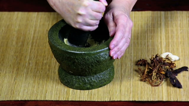 Pulverizing Asian Spices In A Mortar