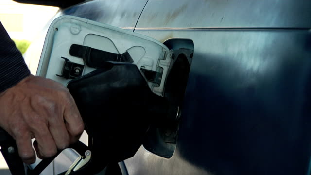 pumping gas in a car - refueling stock videos & royalty-free footage