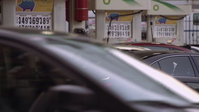 pumping gas in manhattan - gas station attendant stock videos and b-roll footage