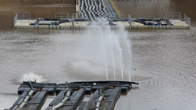 pumping out water from toddbrook reservoir above whaley bridge in derbyshire. torrential rain lead the dam to overflow causing extensive damage to the structure. fearing the dam could collapse, 1500 residents below were evacuated for around a week while t - pipe stock videos & royalty-free footage