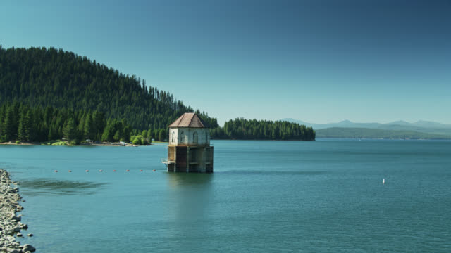 pumping station on lake almanor - drone shot - pumping station stock videos & royalty-free footage