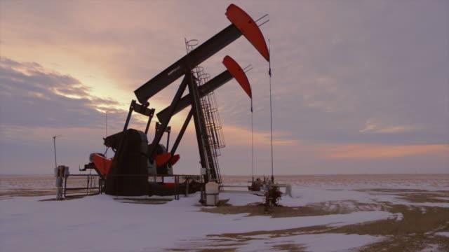 pumpjack at sunset - prairie stock videos & royalty-free footage