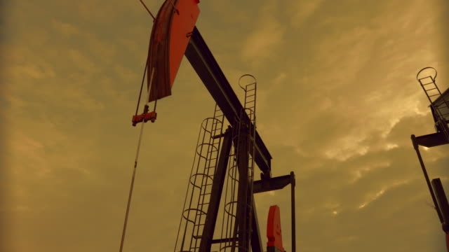 pumpjack at sunset - oil stock videos & royalty-free footage