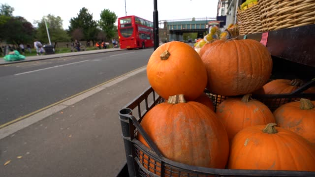 pumpkins on sale outside a greengrocers on october 19, 2020 in london, england. - public celebratory event stock videos & royalty-free footage