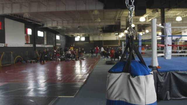 punching bag in gym where mma fighters train - punch bag stock videos & royalty-free footage