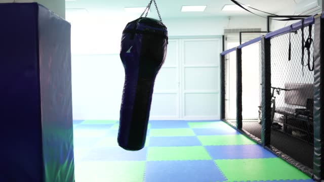 punching bag swinging in gym - sports training stock videos & royalty-free footage
