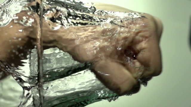 punching the water with hand - super slow motion hd - punching stock videos and b-roll footage