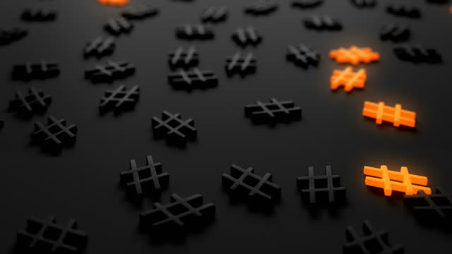 Punctuation marks as a background. Contrasting symbols highlighted in orange. On a dark background question mark, exclamation mark, e-mail, hashtag.