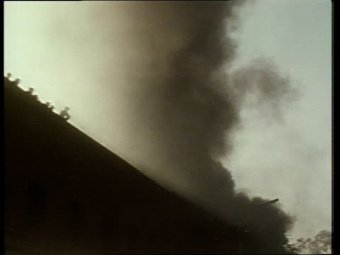 punjab chyandigarh coach on fire bv ditto lms ditto la smoke rising above high wall cu int of building on fire ms wounded man helped along track rl... - 1984 stock videos & royalty-free footage