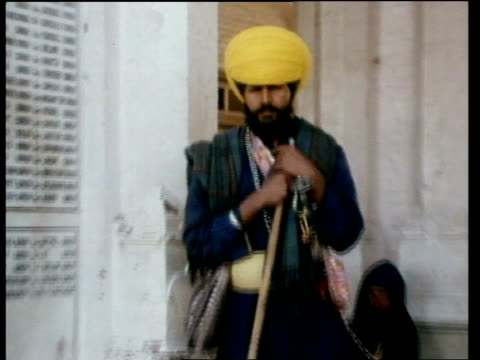 punjab sikhs ** itn cuts 831983 ** punjab amritsar ext ts sikh pilgrims to and from golden temple ts sikhs along walkway to and from temple ms sikh... - pilgrimage stock videos & royalty-free footage