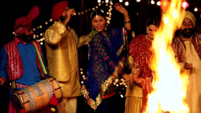 punjabi family celebrating lohri festival, punjab, india - punjab india stock videos and b-roll footage